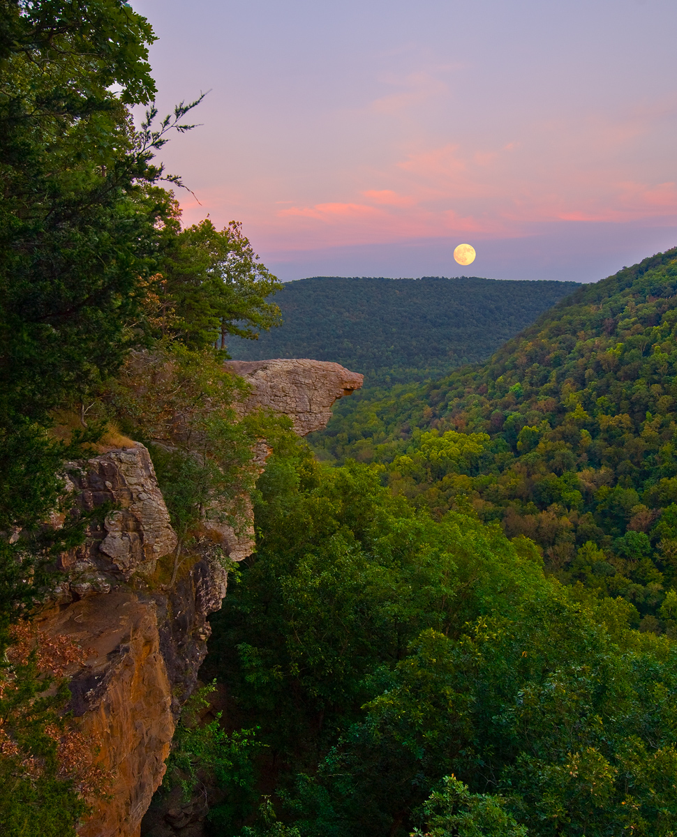 A full moon rises through thin clouds at sunset - Hawksbill Crag.