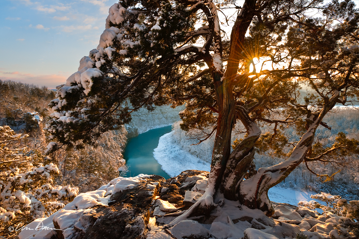 A fresh blanket of snow covers the landscape at sunset along the Buffalo River.